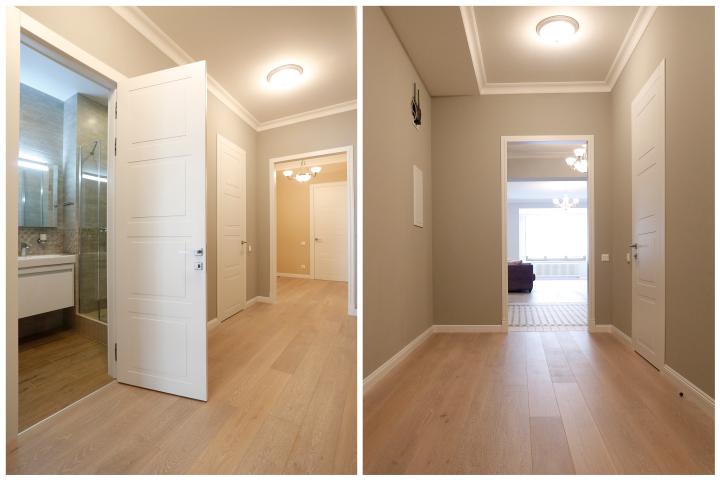 Вид коридора с белыми нестандартными дверьми