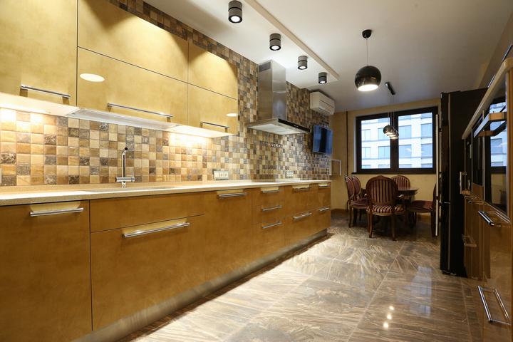 Фартук в виде мозаики по проекту и ремонту кухни от Ремэлль