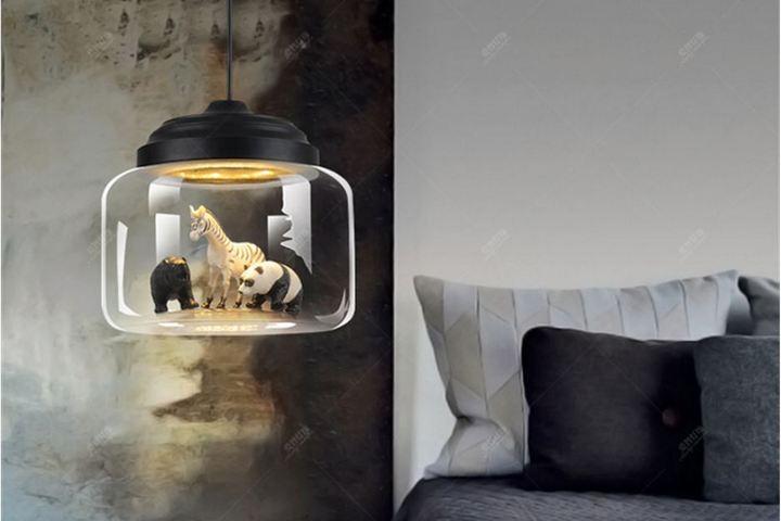 Светильник с фигурками внутри