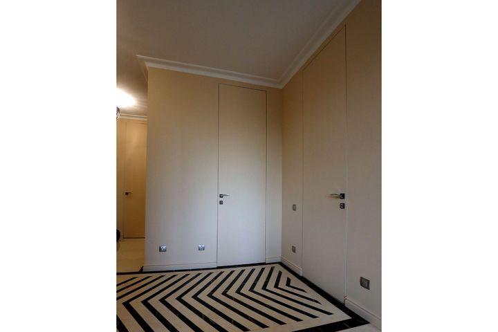 Двери Invisible в цвет общей отделки стен