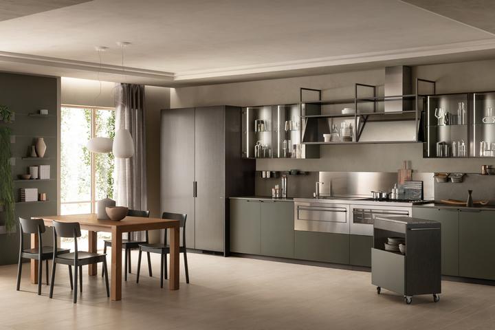Кухня в индустриальном стиле с зелеными фасадами