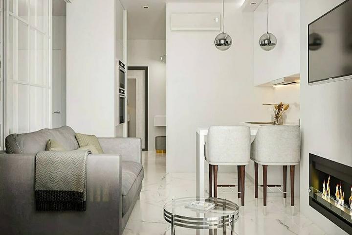 Компактная кухня-гостиная с камином