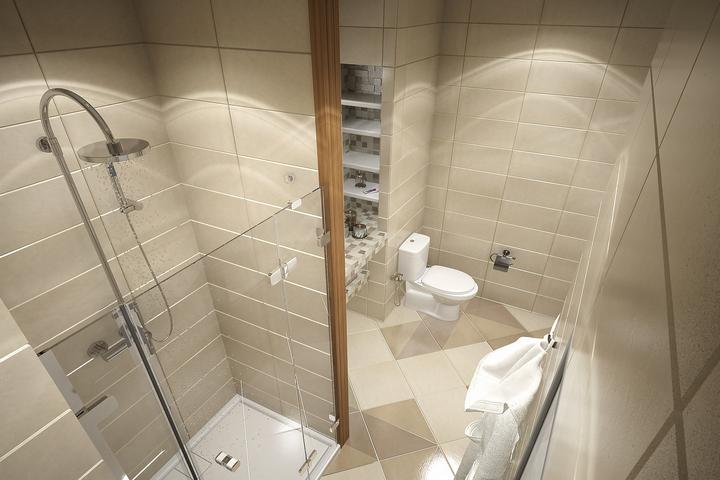 Бежевая отделка ванной с душевой