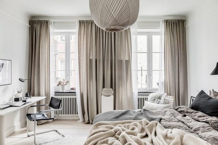 Светлые полупрозрачные гардины в спальне