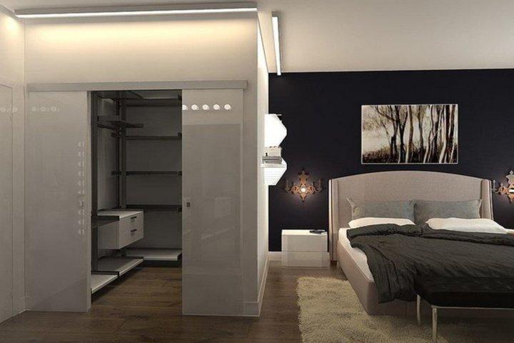 Зонирование в спальне с гардеробной