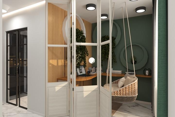 Кресло из ротанга в небольшом кабинете за складной дверью