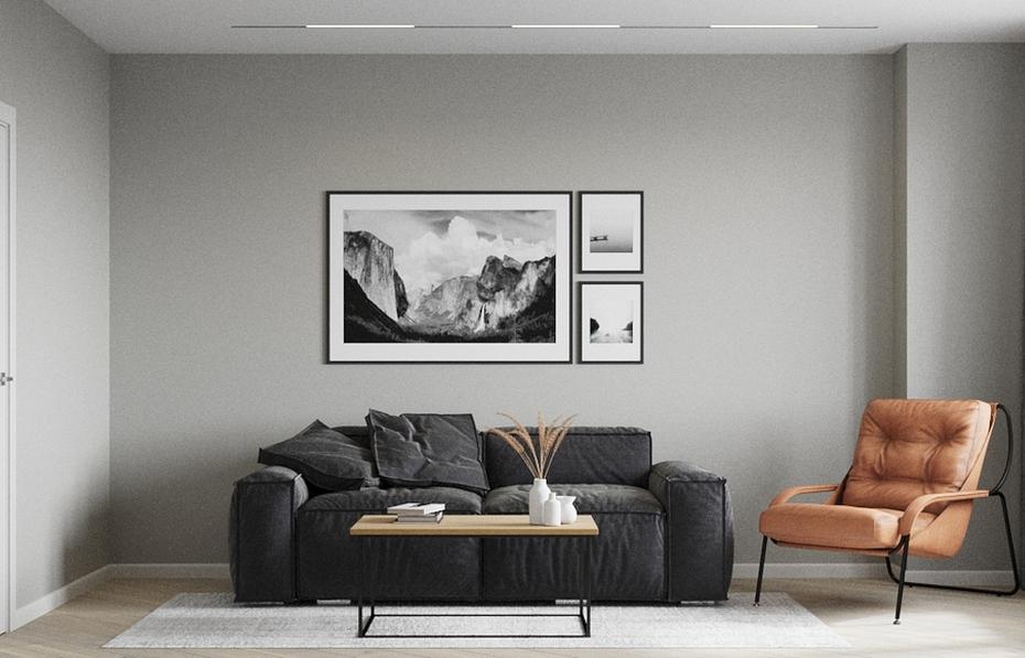 Черный диван в серой гостиной