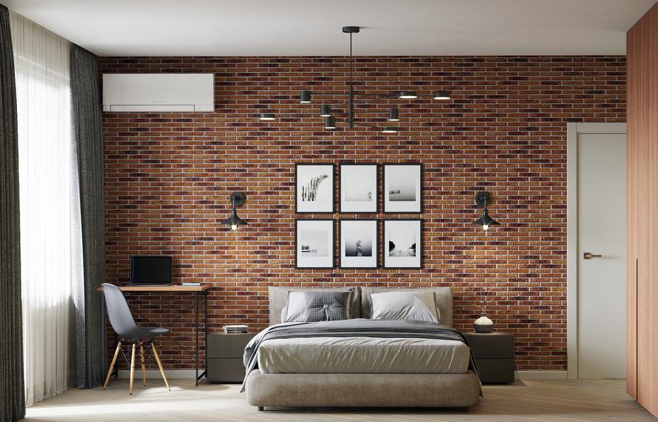 Спальня со стеной из кирпича